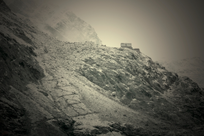 Artsy shot of Moiry lodge perched on a cliff, Valais
